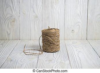skein of thread on a wooden background