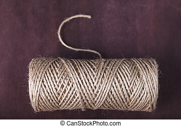 skein of twine on a brown background