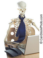 Skeleton at Work 2 - A skeleton sits at a desk working on a...