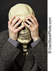 Skeleton covering his eyes