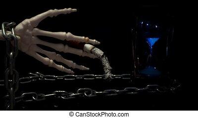 Skeleton hand holding a cigarette.