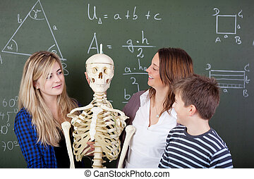Skeleton in class with teacher and students