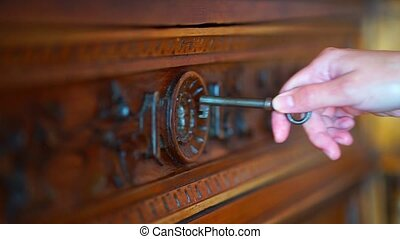 Skeleton key going into old retro keyhole lock. 1920 1080 video for your design