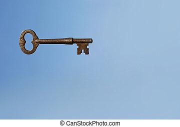 Skeleton Key on Blue Sky Background
