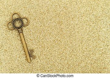 Skeleton keys on gold sparkle background