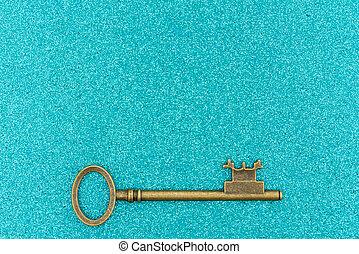Skeleton keys on teal sparkle background