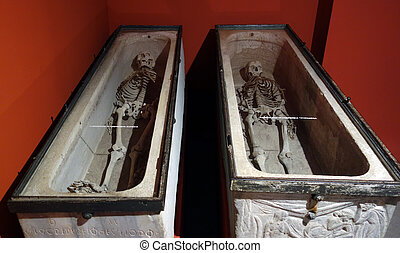 skeletons in stone carved tomb