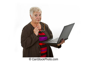 Skeptic female senior with laptop