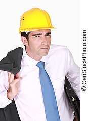 Skeptical businessman in a hardhat