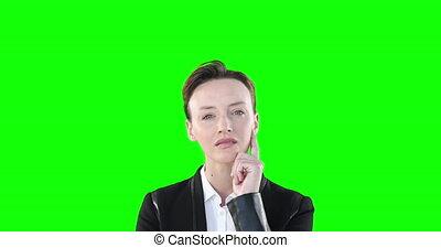Skeptical Caucasian woman looking at camera on green ...