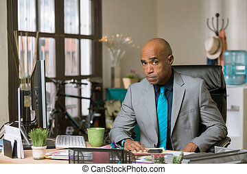 Skeptical Man in a Creative Office