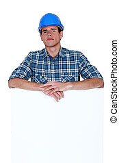 Skeptical workman with a blank board