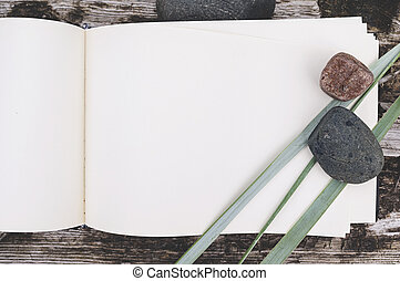 sketch book, country flowers and stones on weathered wood, mock up