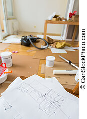 Sketch of home renovation in room full of painting tools