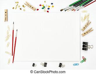 Sketchbook, brushes, paper, office supplies creative art