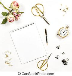 Sketchbook, flowers, office tools. Flat lay notebook
