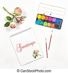 Sketchbook watercolor brushes paper flowers greetings