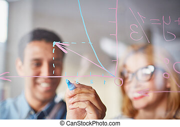 Sketching graph - Businessman sketching graph on transparent...