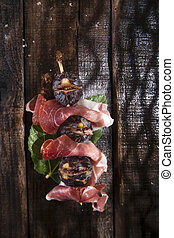 Skewer ham and figs
