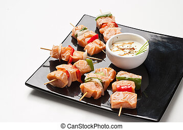 skewers of grilled salmon
