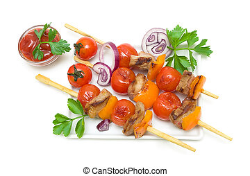 skewers of meat with vegetables isolated on a white background
