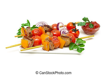 skewers of meat with vegetables on a white background