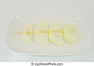 Skewers with fresh onions on the white plate - isolated