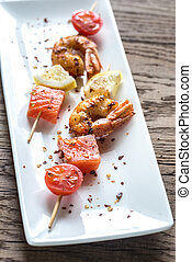 Skewers with shrimps and salmon
