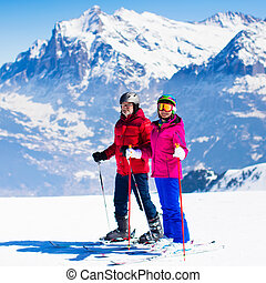 Ski and snow fun in winter mountains - Happy mature couple...