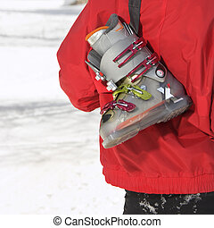 Ski boot. - Close up of ski boot hung over shoulder of...