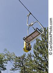 Ski chair lift carry summer toboggan sled
