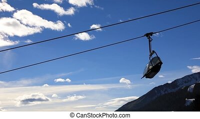 Ski chair lift with skiers - Ski lift chairs on a winter...