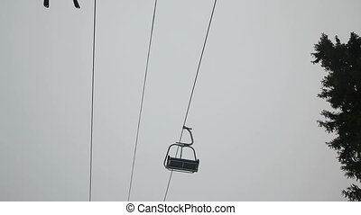 Ski chair lift with skiers - Ski lift chairs on winter...