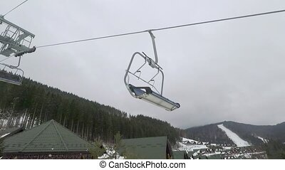 Ski elevator for transportation skiers and snowboarders on...