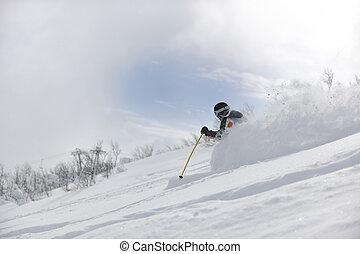 ski freeride - man ski free ride downhill at winter season...
