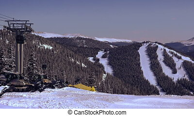 Ski Gondola Running Over Ski Runs - The snowboard gondola...
