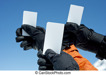 Ski lift admission ticket - Gloved hands holding lift pass...