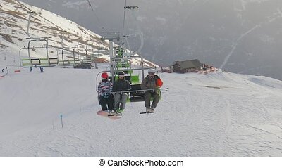 Ski lift ascend - Skilift used by a group of young skier...
