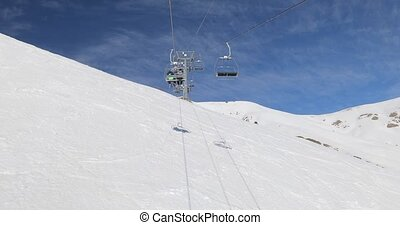 Using ski lift in the Alps