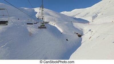 Using ski lift in the Alps in Val d'Allos, France