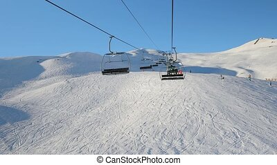 Ski lift ascend - Using ski lift in the Alps