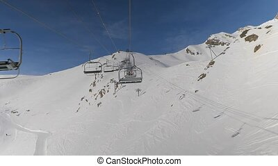 Ski lift ascend - Using ski lift in the Alps, Val d'Allos...