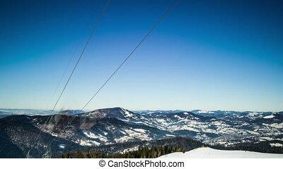 Ski lift at ski resort in sunny Carpatian mountains, time...