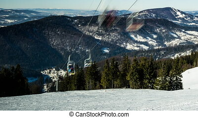 Ski lift at ski resort in sunny Carpatian mountains, time...