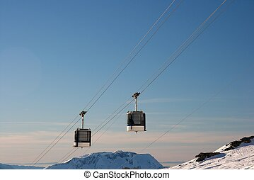 Ski lift cabins on the cable