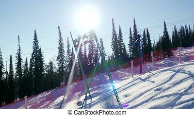 Ski lift chairs on winter day.Modern chair ski lift in ski...