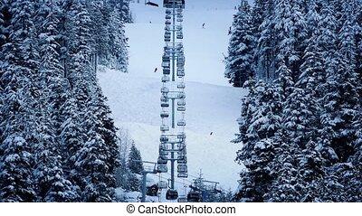 Ski lift Going Up Snowy Mountain - Skilift through the...