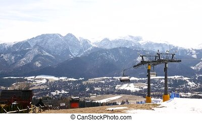 Ski lift in the off-season on a background of mountains.