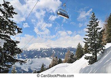 Ski lift in winter mountain landscape