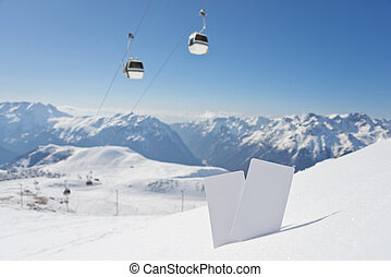 Ski lift pass and panorama - Lift pass card in snow with...